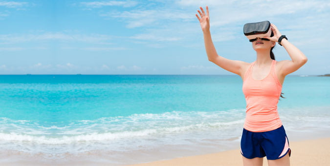 Woman on the beach with headset on