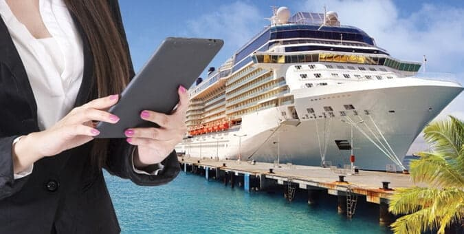 Business woman with tablet standing in front of cruise ship optimizing ship management operations with a powerful SPMS.