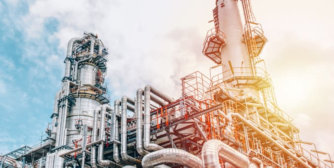Oil pipelines with valves at a refinery where the machines communicate using microprocessors