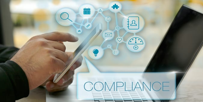 Man using custom supply chain management software to track supplier compliance and performance.