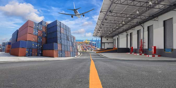 picture of cargo and a plane flying overhead representing supply chain