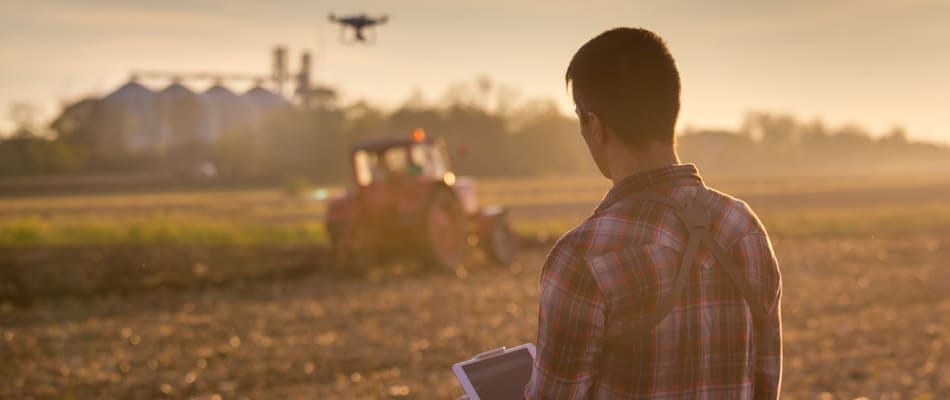attractive farmer navigating drone