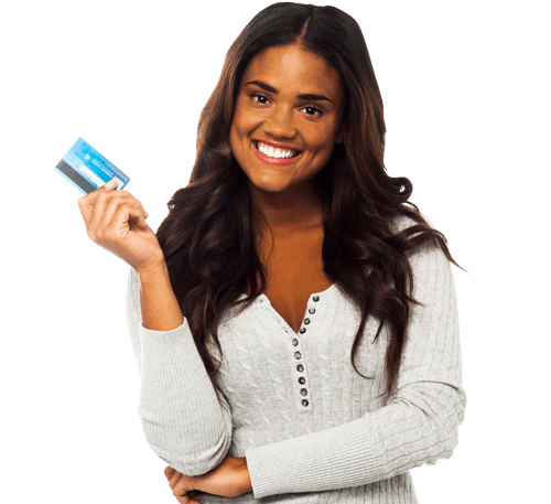 woman holds up a credit card