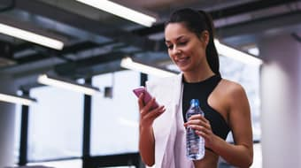 woman using personal trainer app developed by Chetu