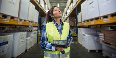 Woman checking inventory to replenish stock