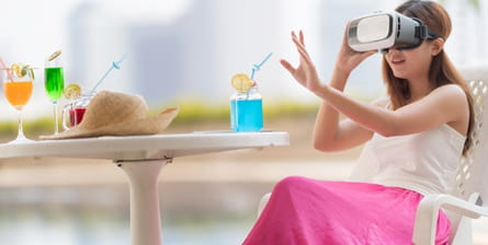 Smiling woman wearing virtual reality headset experiencing vacation destinations.