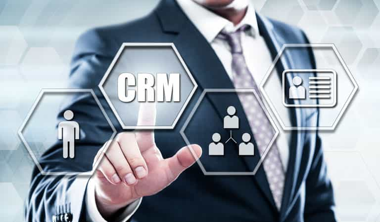 Man clickinfg on CRM